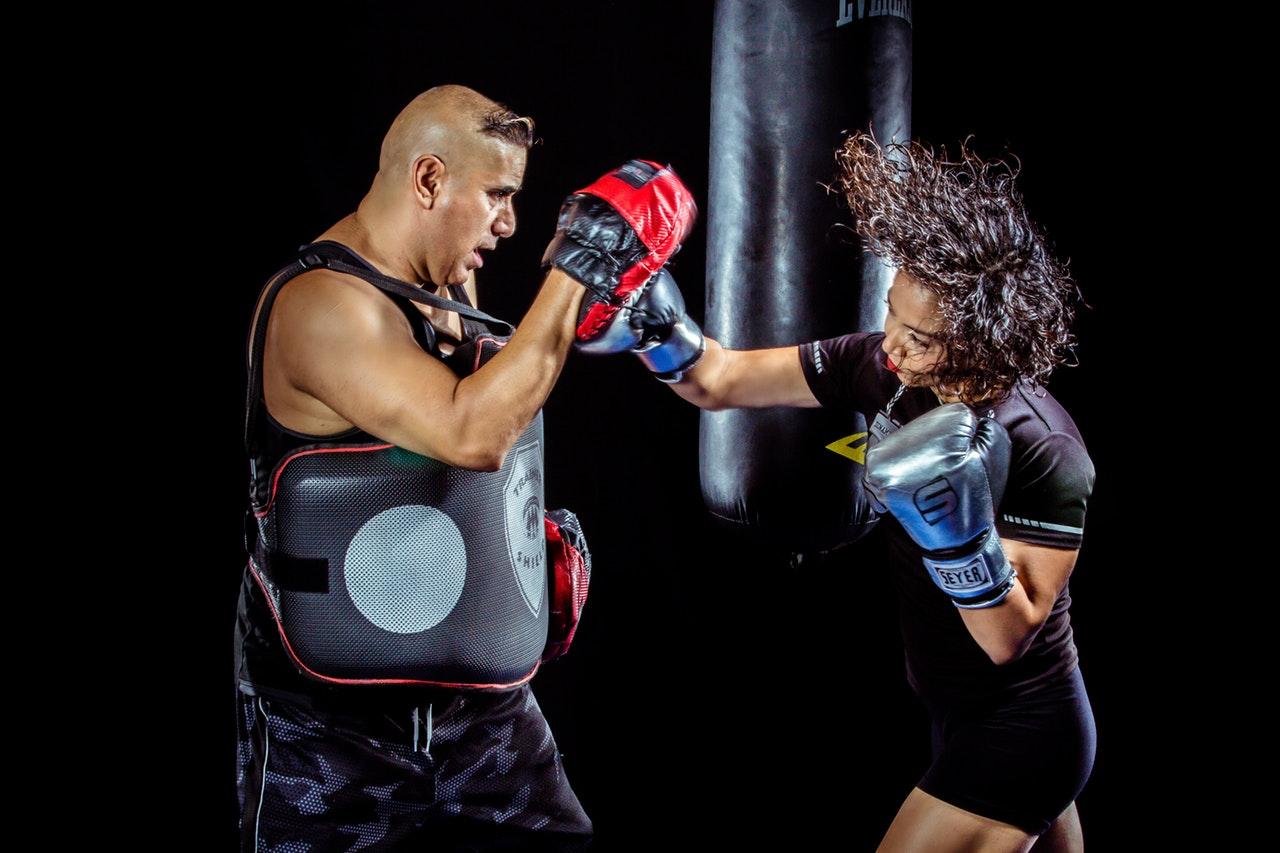 boxing hitting pads woman